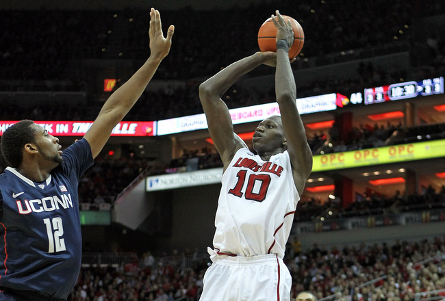LOUISVILLE, KY - FEBRUARY 06:  Gorgui Dieng #10 of the Louisville Cardinals shoots the ball during the Big East Conference game against the Connecticut Huskies at KFC YUM! Center on February 6, 2012 in Louisville, Kentucky.  (Photo by Andy Lyons/Getty Images)