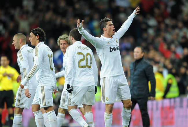 MADRID, SPAIN - FEBRUARY 12:  Cristiano Ronaldo (R) of Real Madrid celebrates scoring his sides second goal during the la Liga match between Real Madrid and Levante at Estadio Santiago Bernabeu on February 12, 2012 in Madrid, Spain.  (Photo by Jasper Juinen/Getty Images)