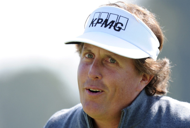 Play it where it lies: Mickelson's tee shot ends up in fan's shorts