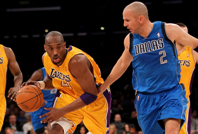 LOS ANGELES, CA - JANUARY 16:  Kobe Bryant #24 of the Los Angeles Lakers drives against Jason Kidd#2 of the Dallas Mavericks at Staples Center on January 16, 2012 in Los Angeles, California.  The Lakers won 73-70.  NOTE TO USER: User expressly acknowledges and agrees that, by downloading and or using this photograph, User is consenting to the terms and conditions of the Getty Images License Agreement.  (Photo by Stephen Dunn/Getty Images)