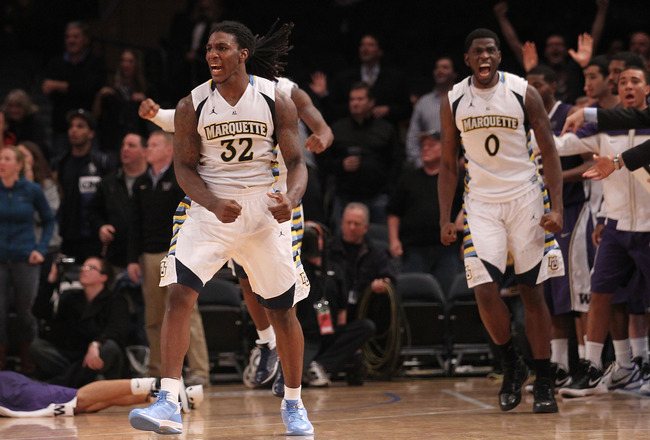 NEW YORK, NY - DECEMBER 06:  Jae Crowder #32 and Jamil Wilson #0 of the Marquette Golden Eagles celebrate defeating the Washington Huskies during the Jimmy V Men's Basketball Classic at Madison Square Garden on December 6, 2011 in New York City.  (Photo by Nick Laham/Getty Images)