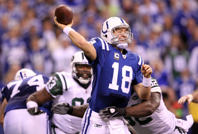 INDIANAPOLIS, IN - JANUARY 08:  Quarterback Peyton Manning #18 of the Indianapolis Colts throws a pss under pressure against the New York Jets during their 2011 AFC wild card playoff game at Lucas Oil Stadium on January 8, 2011 in Indianapolis, Indiana. The Jets won 17-16.  (Photo by Andy Lyons/Getty Images)