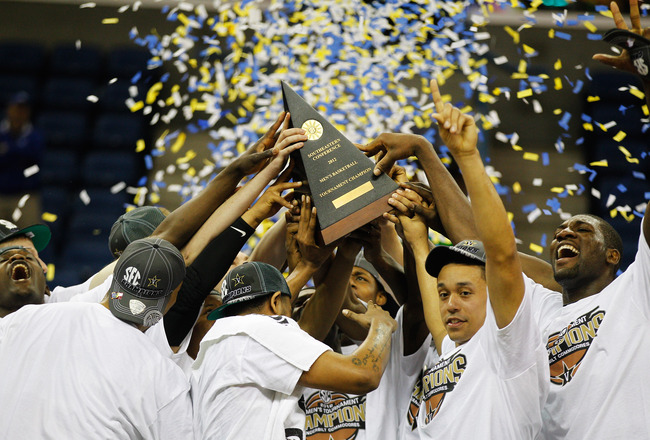 NEW ORLEANS, LA - MARCH 11:  The Vanderbilt Commodores celebrate with the trophy after their 71 to 64 win over the Kentucky Wildcats in the championship game of the 2012 SEC Men's Basketball Tournament at New Orleans Arena on March 11, 2012 in New Orleans, Louisiana.  (Photo by Chris Graythen/Getty Images)