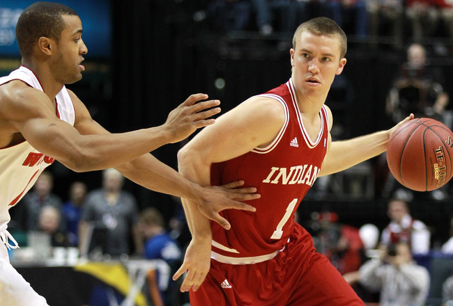 INDIANAPOLIS, IN - MARCH 09:  Jordan Hulls #1 of the Indiana Hoosiers looks to pass against Jordan Taylor #11 of the Wisconsin Badgers during their quarterfinal game of 2012 Big Ten Men's Basketball Conferene Tournament at Bankers Life Fieldhouse on March 9, 2012 in Indianapolis, Indiana  (Photo by Andy Lyons/Getty Images)