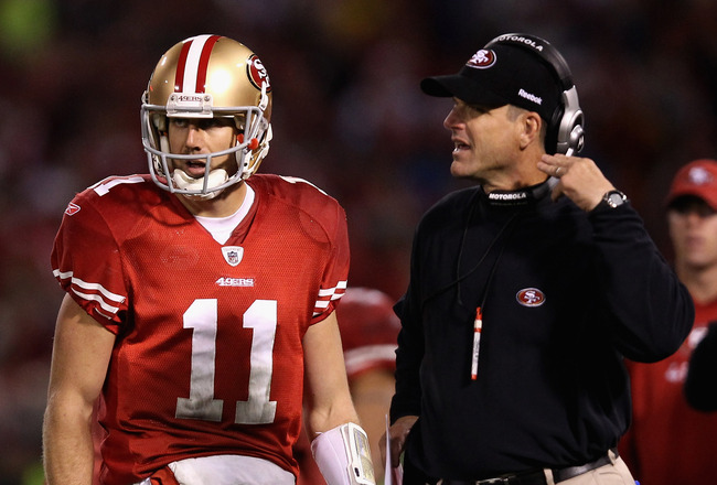 SAN FRANCISCO, CA - JANUARY 22:  Alex Smith #11 of the San Francisco 49ers stands with head coach Jim Harbaugh of the San Francisco 49ers during the fourth quarter of the NFC Championship Game against the New York Giants at Candlestick Park on January 22, 2012 in San Francisco, California.  (Photo by Ezra Shaw/Getty Images)