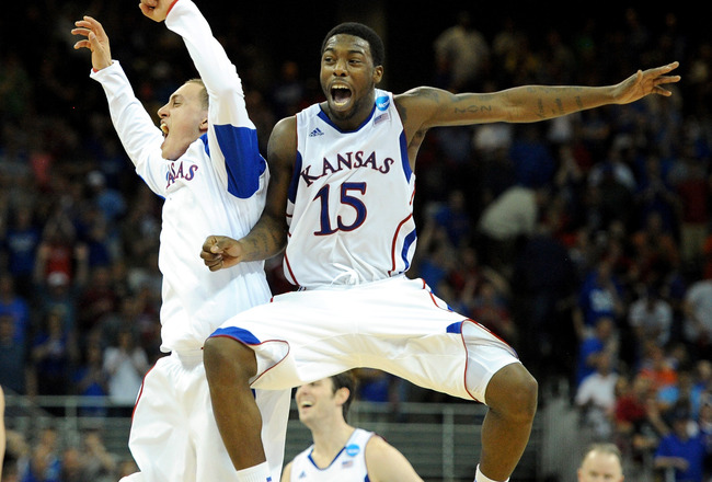 OMAHA, NE - MARCH 18:  Elijah Johnson #15 of the Kansas Jayhawks celebrates with teammates after they won 63-60 against the Purdue Boilermakers during the third round of the 2012 NCAA Men's Basketball Tournament at CenturyLink Center on March 18, 2012 in Omaha, Nebraska.  (Photo by Eric Francis/Getty Images)