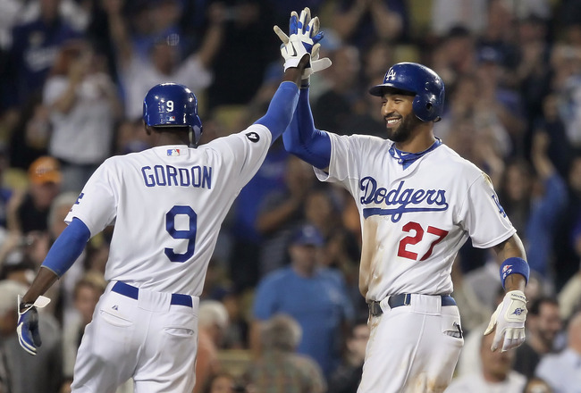 LOS ANGELES, CA - SEPTEMBER 22:  Matt Kemp (R) #27 of the Los Angeles Dodgers is congratulated by Dee Gordon #9 after hitting a two-run home run against the San Francisco Giants in the eighth inning at Dodger Stadium on September 22, 2011 in Los Angeles, California. The Dodgers defeated the Giants 8-2.  (Photo by Jeff Gross/Getty Images)