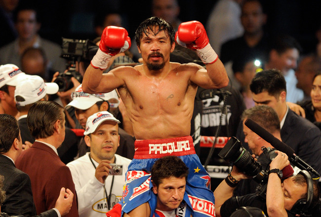 LAS VEGAS, NV - NOVEMBER 12: Manny Pacquiao celebrates his majority decision victory against Juan Manuel Marquez in the WBO world welterweight title fight at the MGM Grand Garden Arena on November 12, 2011 in Las Vegas, Nevada. (Photo by Ethan Miller/Getty Images)