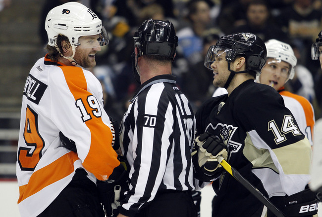 PITTSBURGH, PA - DECEMBER 29: Scott Hartnell #19 of the Philadelphia Flyers has words with Chris Kunitz #14 of the Pittsburgh Penguins during the game at Consol Energy Center on December 29, 2011 in Pittsburgh, Pennsylvania. (Photo by Justin K. Aller/Getty Images)
