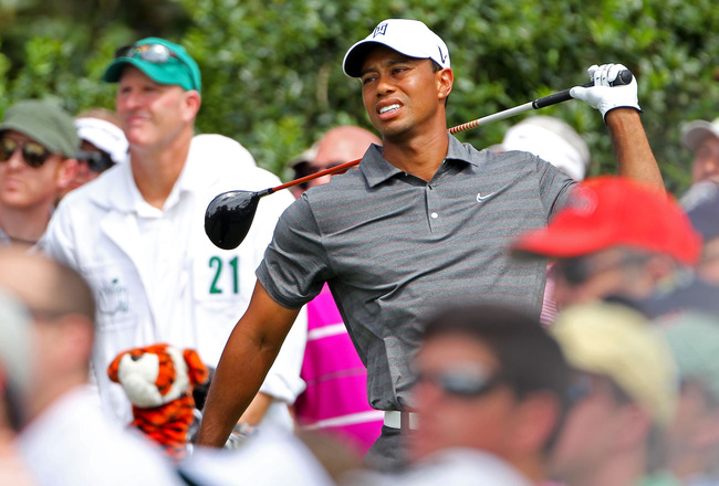 Ineffective Tiger apologises for Masters club-kicking