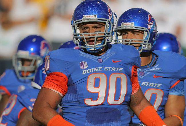 FORT COLLINS, CO - OCTOBER 15:  Billy Winn #90 and the Boise State Broncos defense face the Colorado State Rams at Sonny Lubick Field at Hughes Stadium on October 15, 2011 in Fort Collins, Colorado. The Broncos defeated the Rams 63-13.  (Photo by Doug Pensinger/Getty Images)