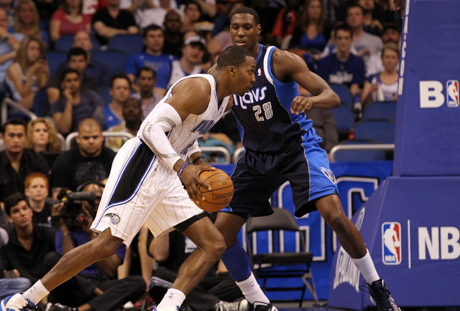 ORLANDO, FL - MARCH 30: Dwight Howard #12 of the Orlando Magic drives