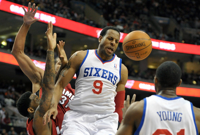 PHILADELPHIA, PA - MARCH 16: Andre Iguodala #9 of the Philadelphia 76ers passes to teammate Thaddeus Young #21 during the game against the Miami Heat at the Wells Fargo Center on March 16, 2012 in Philadelphia, Pennsylvania. NOTE TO USER: User expressly acknowledges and agrees that, by downloading and or using this photograph, User is consenting to the terms and conditions of the Getty Images License Agreement. (Photo by Drew Hallowell/Getty Images)