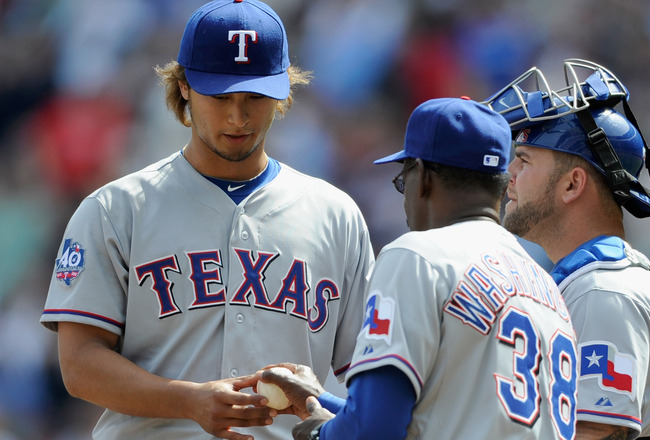 MINNEAPOLIS, MN - APRIL 14: Yu Darvish #11 of the Texas Rangers hands the ball to manager Ron Washington #38 during the sixth inning against the Minnesota Twins on April 14, 2012 at Target Field in Minneapolis, Minnesota. (Photo by Hannah Foslien/Getty Images)