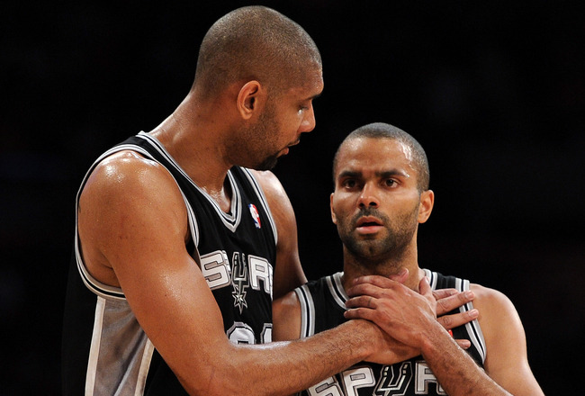 LOS ANGELES, CA - APRIL 17:  Tim Duncan #21 and Tony Parker #9 of the San Antonio Spurs talk during a break in the game against the Los Angeles Lakers at Staples Center on April 17, 2012 in Los Angeles, California.  NOTE TO USER: User expressly acknowledges and agrees that, by downloading and or using this photograph, User is consenting to the terms and conditions of the Getty Images License Agreement.  (Photo by Harry How/Getty Images)