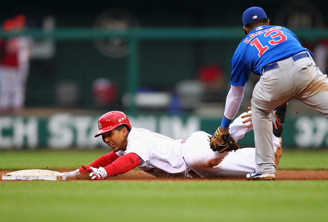 ST. LOUIS, MO - APRIL 13: Jon Jay #19 of the St. Louis Cardinals slides safely into second base against the Chicago Cubs during the home-opening game at Busch Stadium on April 13, 2012 in St. Louis, Missouri.  The Cubs beat the Cardinals 9-5.  (Photo by Dilip Vishwanat/Getty Images)