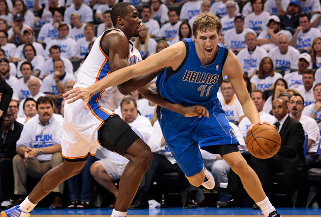 OKLAHOMA CITY, OK - APRIL 30:  Dirk Nowitzki #41 of the Dallas Mavericks drives on Serge Ibaka #9 of the Oklahoma City Thunder in Game Two of the Western Conference Quarterfinals in the 2012 NBA Playoffs on April 30, 2012 at the Chesapeake Energy Arena in Oklahoma City, Oklahoma. Oklahoma City defeated Dallas 102-99. NOTE TO USER: User expressly acknowledges and agrees that, by downloading and or using the photograph, User is consenting to the terms and conditions of the Getty Images License Agreement. (Photo by Brett Deering/Getty Images)