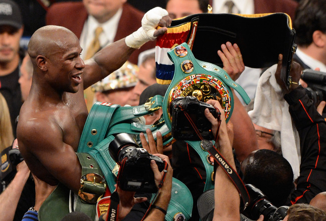 LAS VEGAS, NV - MAY 05:  Floyd Mayweather Jr. celebrates after defeating Miguel Cotto by unanimous decision in their WBA super welterweight title fight at the MGM Grand Garden Arena on May 5, 2012 in Las Vegas, Nevada.  (Photo by Ethan Miller/Getty Images)