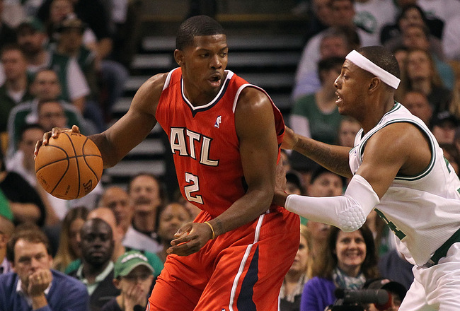 BOSTON, MA - MAY 04:  Joe Johnson #2 of the Atlanta Hawks works his way to the basket against Paul Pierce #34 of the Boston Celtics in Game Three of the Eastern Conference Quarterfinals during the 2012 NBA Playoffs on May 4, 2012 at TD Garden in Boston, Massachusetts. NOTE TO USER: User expressly acknowledges and agrees that, by downloading and or using this photograph, User is consenting to the terms and conditions of the Getty Images License Agreement. (Photo by Jim Rogash/Getty Images)
