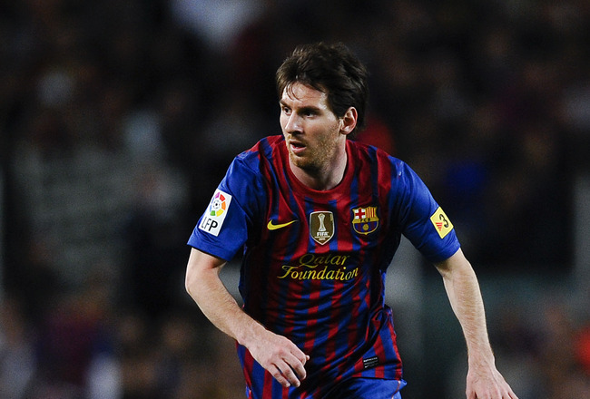 BARCELONA, SPAIN - MAY 05: Lionel Messi of FC Barcelona runs with the ball during the La Liga match between FC Barcelona and RCD Espanyol at Camp Nou on May 5, 2012 in Barcelona, Spain.  (Photo by David Ramos/Getty Images)