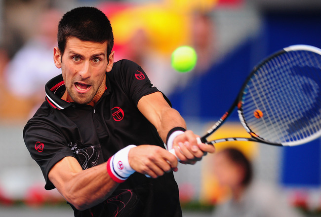 MADRID, SPAIN - MAY 08:  Novak Djokovic of Serbia in action against Daniel Gimeno-Traver of Spain in the 2nd round of the Mutua Madrilena Madrid Open at the Caja Magica on May 8, 2012 in Madrid, Spain.  (Photo by Mike Hewitt/Getty Images)