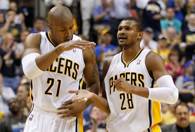 INDIANAPOLIS, IN - MAY 08: Leandro Barbosa #28 of the Indiana Pacers celebrate a late fourth quarter basket with David West #21 while playing the Orlando Magic in Game Five of the Eastern Conference Quarterfinals during the 2012 NBA Playoffs on May 8, 2012 at Bankers Life Fieldhouse in Indianapolis, Indiana. Indiana won the game 105-87 to to win the series 3-1. NOTE TO USER: User expressly acknowledges and agrees that, by downloading and or using this photograph, User is consenting to the terms and conditions of the Getty Images License Agreement. (Photo by Gregory Shamus/Getty Images)