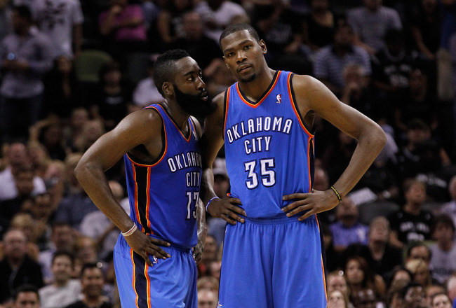 SAN ANTONIO, TX - MAY 29:  James Harden #13 talks with Kevin Durant #35 of the Oklahoma City Thunder in the fourth quarter while taking on the San Antonio Spurs in Game Two of the Western Conference Finals of the 2012 NBA Playoffs at AT&T Center on May 29, 2012 in San Antonio, Texas. NOTE TO USER: User expressly acknowledges and agrees that, by downloading and or using this photograph, user is consenting to the terms and conditions of the Getty Images License Agreement.  (Photo by Tom Pennington/Getty Images)
