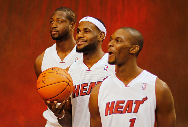 MIAMI, FL - DECEMBER 12:  Dwyane Wade #3, LeBron James #6, and Chris Bosh #1 of the Miami Heat poses during media day at American Airlines Arena on December 12, 2011 in Miami, Florida.  (Photo by Mike Ehrmann/Getty Images)