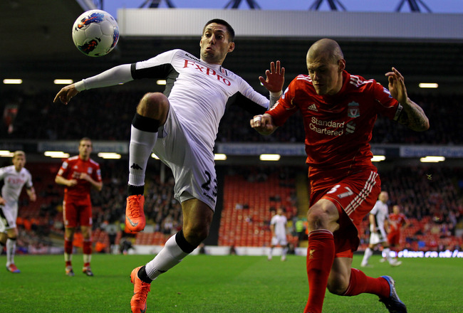 LIVERPOOL, ENGLAND - MAY 01:  Martin Skrtel of Liverpool competes with Clint Dempsey of Fulham during the Barclays Premier League match between Liverpool and Fulham at Anfield on May 1, 2012 in Liverpool, England.  (Photo by Clive Brunskill/Getty Images)