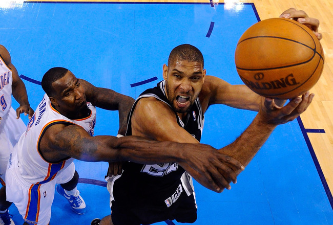 OKLAHOMA CITY, OK - JUNE 02:  Tim Duncan #21 of the San Antonio Spurs looks to shoot over Kendrick Perkins #5 of the Oklahoma City Thunder in the second half in Game Four of the Western Conference Finals of the 2012 NBA Playoffs at Chesapeake Energy Arena on June 2, 2012 in Oklahoma City, Oklahoma. NOTE TO USER: User expressly acknowledges and agrees that, by downloading and or using this photograph, User is consenting to the terms and conditions of the Getty Images License Agreement.  (Photo by Larry W. Smith/Pool/Getty Images)