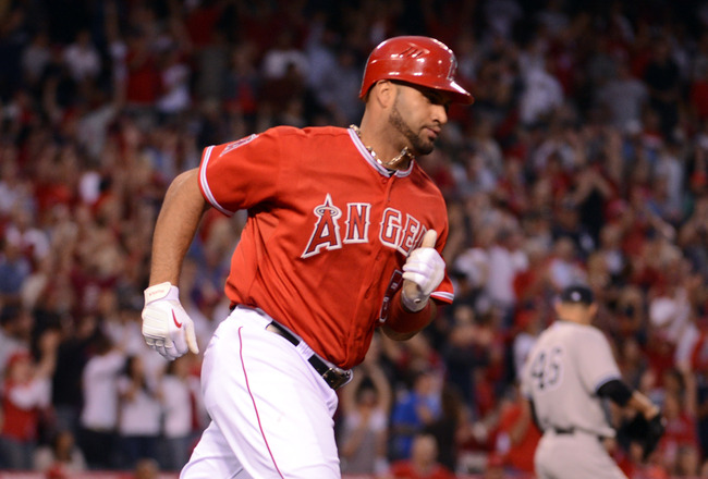 ANAHEIM, CA - MAY 29:  Albert Pujols #5 of the Los Angeles Angels runs to first after his 2 run homerun in front of Andy Pettitte #46 of the New York Yankees for a 3-0 lead duing the third inning at Angel Stadium of Anaheim on May 29, 2012 in Anaheim, California.  (Photo by Harry How/Getty Images)