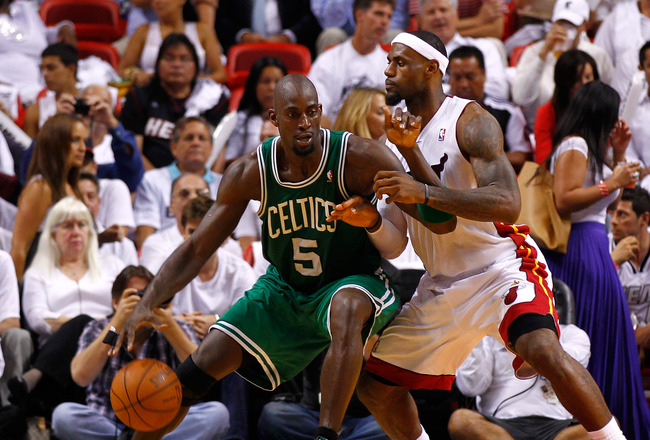 MIAMI, FL - JUNE 05:  Kevin Garnett #5 of the Boston Celtics posts up against LeBron James #6 of the Miami Heat in Game Five of the Eastern Conference Finals in the 2012 NBA Playoffs on June 5, 2012 at American Airlines Arena in Miami, Florida. NOTE TO USER: User expressly acknowledges and agrees that, by downloading and or using this photograph, User is consenting to the terms and conditions of the Getty Images License Agreement.  (Photo by Mike Ehrmann/Getty Images)