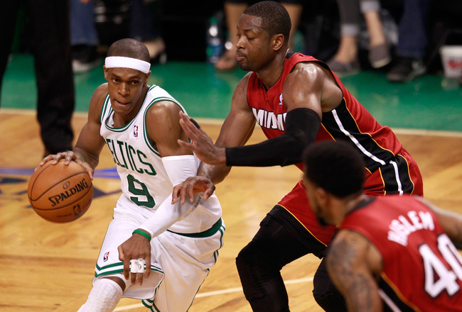 BOSTON, MA - JUNE 07:  Rajon Rondo #9 of the Boston Celtics drives Dwyane Wade #3 and Udonis Haslem #40 of the Miami Heat in Game Six of the Eastern Conference Finals in the 2012 NBA Playoffs on June 7, 2012 at TD Garden in Boston, Massachusetts. NOTE TO USER: User expressly acknowledges and agrees that, by downloading and or using this photograph, User is consenting to the terms and conditions of the Getty Images License Agreement.  (Photo by Jared Wickerham/Getty Images)