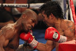 Pacquiao Stunned by Bradley in Controversial Decision
