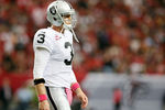 ATLANTA, GA - OCTOBER 14:  Carson Palmer #3 of the Oakland Raiders walks off the field during a timeout against the Atlanta Falcons at Georgia Dome on October 14, 2012 in Atlanta, Georgia.  (Photo by Kevin C. Cox/Getty Images)