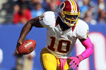 EAST RUTHERFORD, NJ - OCTOBER 21: Quarterback Robert Griffin III #10 of the Washington Redskins runs against the New York Giants during their game at MetLife Stadium on October 21, 2012 in East Rutherford, New Jersey.  (Photo by Alex Trautwig/Getty Images)