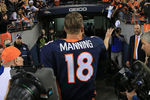 DENVER, CO - NOVEMBER 18:  Quarterback Peyton Manning #18 of the Denver Broncos tosses his wrist bands to the fans as he leaves the field after facing the San Diego Chargers at Sports Authority Field at Mile High on November 18, 2012 in Denver, Colorado. The Broncos defeated the Chargers 30-23.  (Photo by Doug Pensinger/Getty Images)