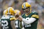 GREEN BAY, WI - DECEMBER 2:  Aaron Rodgers #12 of the Green Bay Packers signals to the official for a hold during a game against the Minnesota Vikings at Lambeau Field on December 2, 2012 in Green Bay, Wisconsin.  The Packers defeated the Vikings 23-14.  (Photo by Wesley Hitt/Getty Images)
