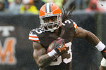 CLEVELAND, OH - OCTOBER 28: Running back Trent Richardson #33 of the Cleveland Browns runs for a gain under pressure from cornerback Antoine Cason #20 of the San Diego Chargers during the first half at Cleveland Browns Stadium on October 28, 2012 in Cleveland, Ohio. (Photo by Jason Miller/Getty Images)