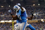 DETROIT, MI - NOVEMBER 22:  Calvin Johnson #81 of the Detroit Lions celebrates a second quarter touchdown with Ryan Broyles #84 while playing the Houston Texans at Ford Field on November 22, 2012 in Detroit, Michigan. (Photo by Gregory Shamus/Getty Images)