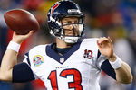 FOXBORO, MA - DECEMBER 10: T.J. Yates #13 of the Houston Texans throws a pass against the New England Patriots during the game at Gillette Stadium on December 10, 2012 in Foxboro, Massachusetts. (Photo by Jared Wickerham/Getty Images)