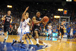 Dec 15, 2012; Lawrence, KS, USA; Kansas Jayhawks guard Niko Roberts (20) fouls Belmont Bruins guard Adam Barnes (24) in the second half at Allen Fieldhouse. Kansas won the game 89-60. Mandatory Credit: John Rieger-USA TODAY Sports