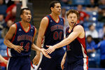 DAYTON, OH - MARCH 19:  (L-R) Stephen Holt #14, Brad Waldow #00 and Matthew Dellavedova #4 of the St. Mary's Gaels react after a play in the second half against the Middle Tennessee Blue Raiders during the first round of the 2013 NCAA Men's Basketball Tournament at University of Dayton Arena on March 19, 2013 in Dayton, Ohio.  (Photo by Gregory Shamus/Getty Images)