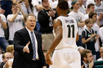 EAST LANSING, MI - MARCH 07:  Head coach Tom Izzo of the Michigan State Spartans congratulates Keith Appling #11 as he leaves the floor in the second half while playing the Wisconsin Badgers at the Jack T. Breslin Student Events Center on March 7, 2013 in East Lansing, Michigan. Michigan State won the game 58-43. (Photo by Gregory Shamus/Getty Images)