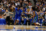 PHILADELPHIA, PA - MARCH 24:  Eric McKnight #12 of the Florida Gulf Coast Eagles celebrates in the second half while taking on the San Diego State Aztecs during the third round of the 2013 NCAA Men's Basketball Tournament at Wells Fargo Center on March 24, 2013 in Philadelphia, Pennsylvania.  (Photo by Rob Carr/Getty Images)