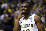 Mar 23, 2013; Auburn Hills, MI, USA; Michigan Wolverines guard Tim Hardaway Jr. (10) celebrates after the game against the Virginia Commonwealth Rams during the third round of the NCAA basketball tournament at The Palace. Michigan won 78-53. Mandatory Credit: Rick Osentoski-USA TODAY Sports