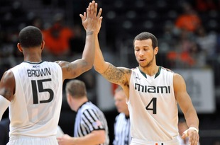 Feb 5, 2013; Coral Gables, FL, USA; Miami Hurricanes guard Trey McKinney Jones (right) greets teammate Rion Brown (left) after Rion made a three point basket against Boston College Eagles during the first half at the BankUnited Center. Mandatory Credit: Steve Mitchell-USA TODAY Sports