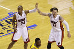 Jun 3, 2013; Miami, FL, USA; Miami Heat shooting guard Ray Allen (34) and shooting guard Mike Miller (13) high five during the second quarter of game 7 of the 2013 NBA Eastern Conference Finals against the Indiana Pacers at American Airlines Arena. Mandatory Credit: Robert Mayer-USA TODAY Sports