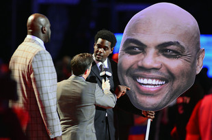 Feb 15, 2013; Houston, TX, USA; Chris Webber is interviewed with a poster of Team Chuck head coach Charles Barkley (not pictured) while Team Shaq head coach Shaquille O'Neal looks on during prior to the rising stars challenge during the 2013 NBA All-Star weekend at the Toyota Center. Mandatory Credit: Bob Donnan-USA TODAY Sports