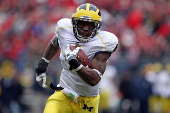 COLUMBUS, OH - NOVEMBER 22:  Brandon Minor #4 of the Michigan Wolverine sruns with the ball during the Big Ten Conference game against the Ohio State Buckeyes at Ohio Stadium on November 22, 2008 in Columbus, Ohio.  (Photo by Andy Lyons/Getty Images)